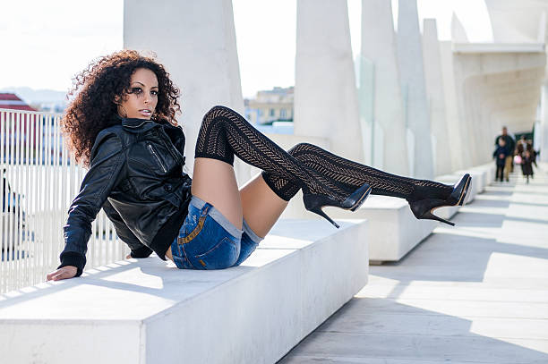 young black woman, afro hairstyle, in urban background - black women wearing pantyhose stock photos and pictures