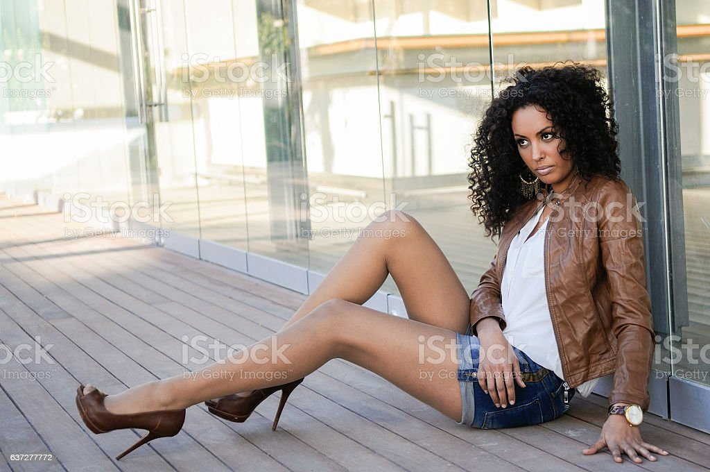 Young black woman, afro hairstyle, in urban background stock photo