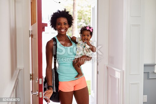 istock Young black woman and child arrive home after exercising 524383670