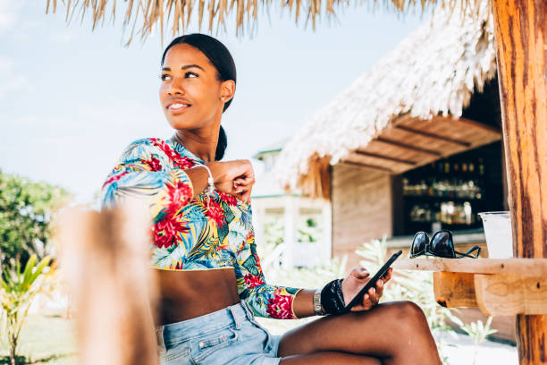 young black woman at resort cabana - caribbean culture stock pictures, royalty-free photos & images