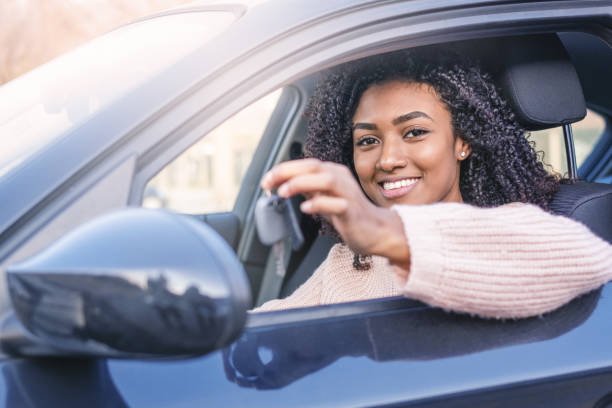 Young black woman at the wheel on her new car stock photo