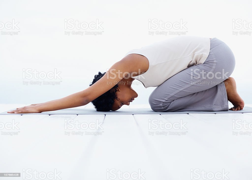 Young, black woman doing yogatic exercise royalty-free stock photo