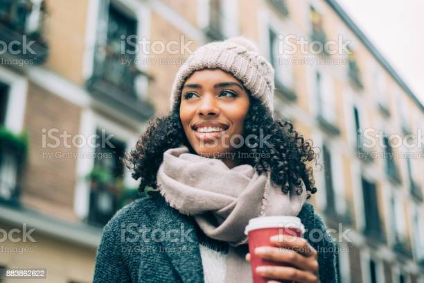 Young black woman drinking coffee wandering in the streets of madrid picture id883862622?b=1&k=6&m=883862622&s=612x612&h=j39fwyiovlco0ljrwma yr8tdpjrdl0uynz490 jeng=