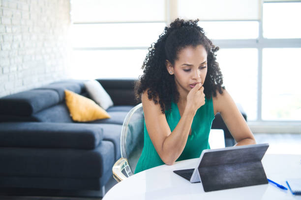 Young Black Woman Feeling Anxious And Biting Nails stock photo