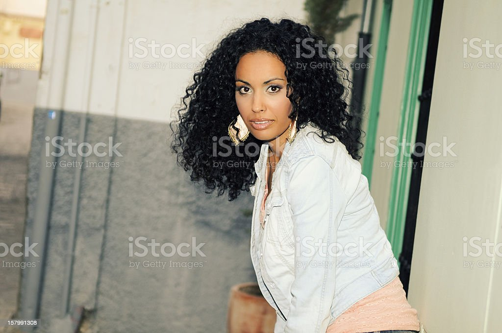 Young black woman, model of fashion in urban background royalty-free stock photo