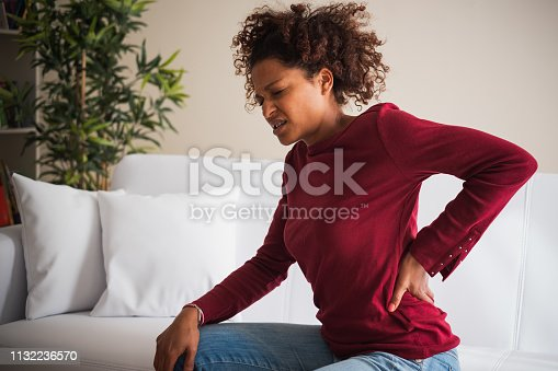istock Young black woman suffer back pain cramp 1132236570