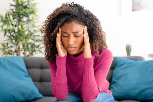 Young black woman suffering bad and strong headache stock photo