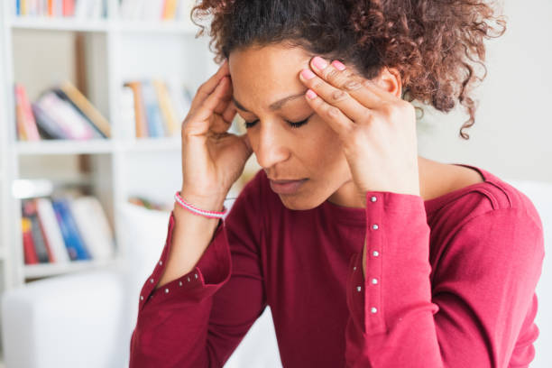 Young black woman suffering strong headache Woman suffering from terrible headache massaging temples headache stock pictures, royalty-free photos & images