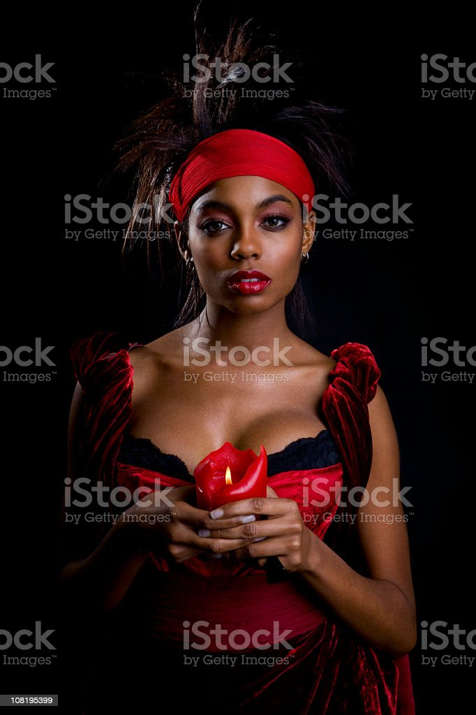 African American Young Woman as Voodoo Fortune Teller on Black stock photo