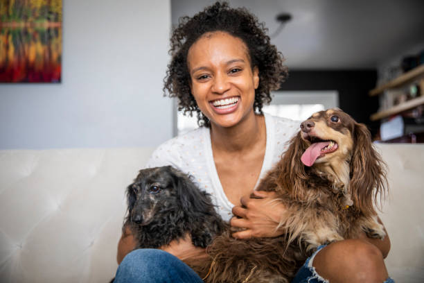 Young black woman with pet dachshunds picture id1162180321?b=1&k=6&m=1162180321&s=612x612&w=0&h=rxrqeab9dljs0ix avtqlsvgadw01dycfyerkekyiby=