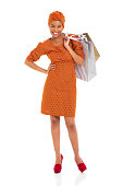 istock young black woman with shopping bags 481114459