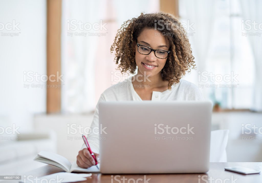 Young black woman working at home stock photo