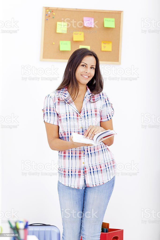 Young blogger reading a book royalty-free stock photo