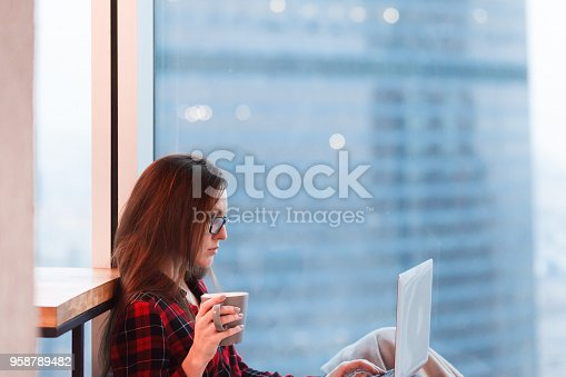 1162297213 istock photo young blogger writes article on a hot topic in the megalopolis 958789482