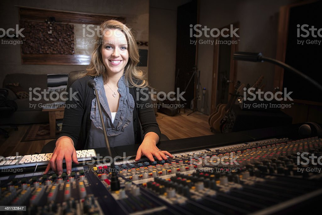 Young Blond Caucasian Woman in her 20s  Recording Console stock photo