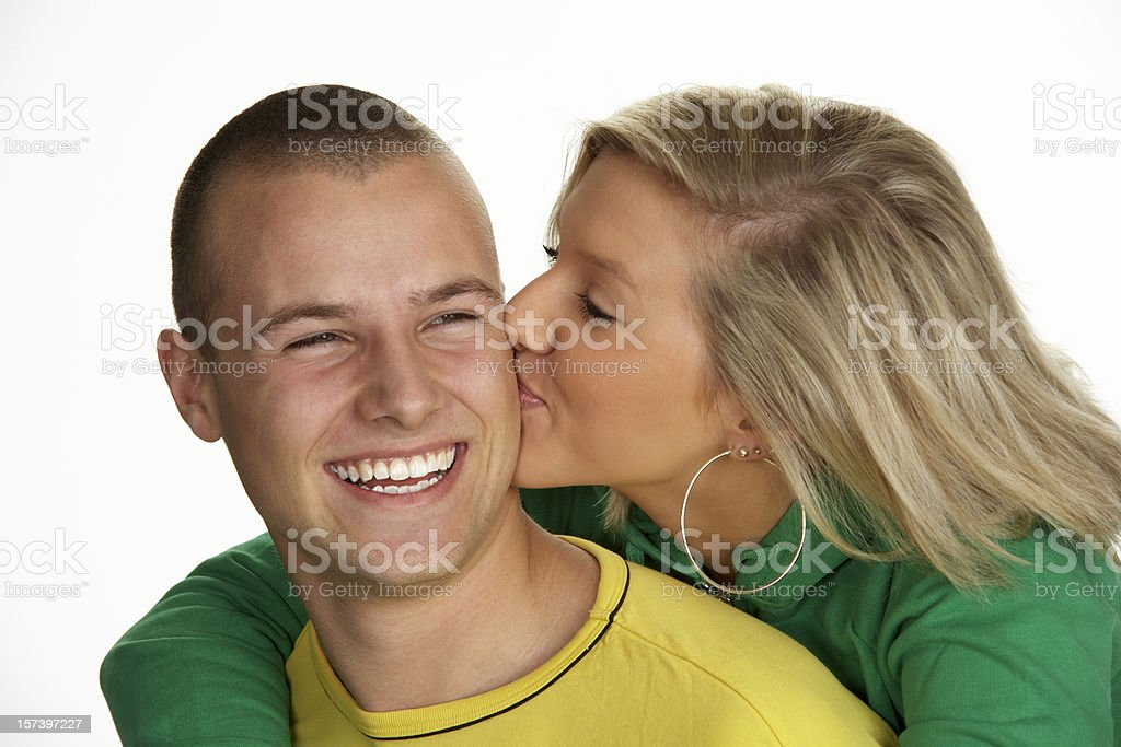 Young blond couple hugging and kissing royalty-free stock photo