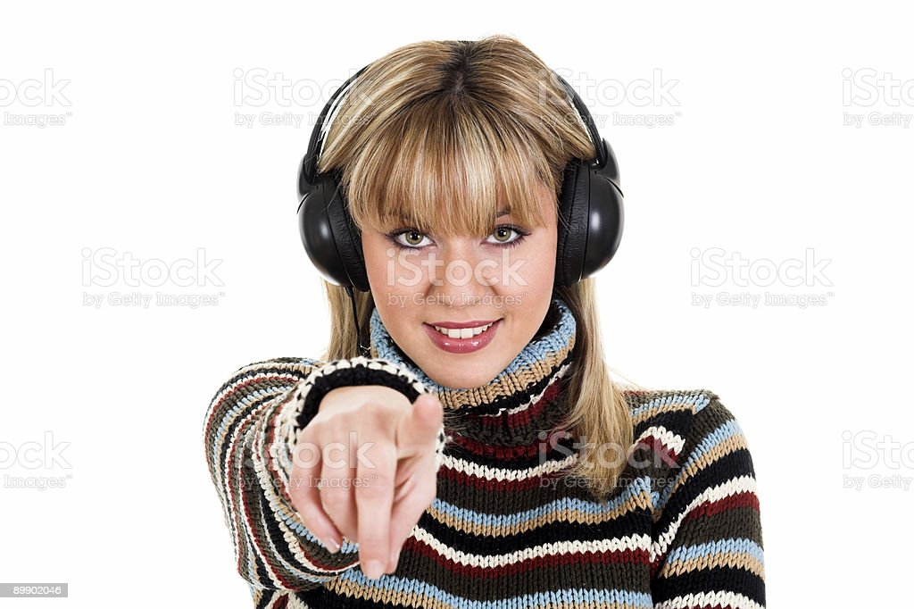 Young blond girl in colorful sweater listening to music royalty-free stock photo