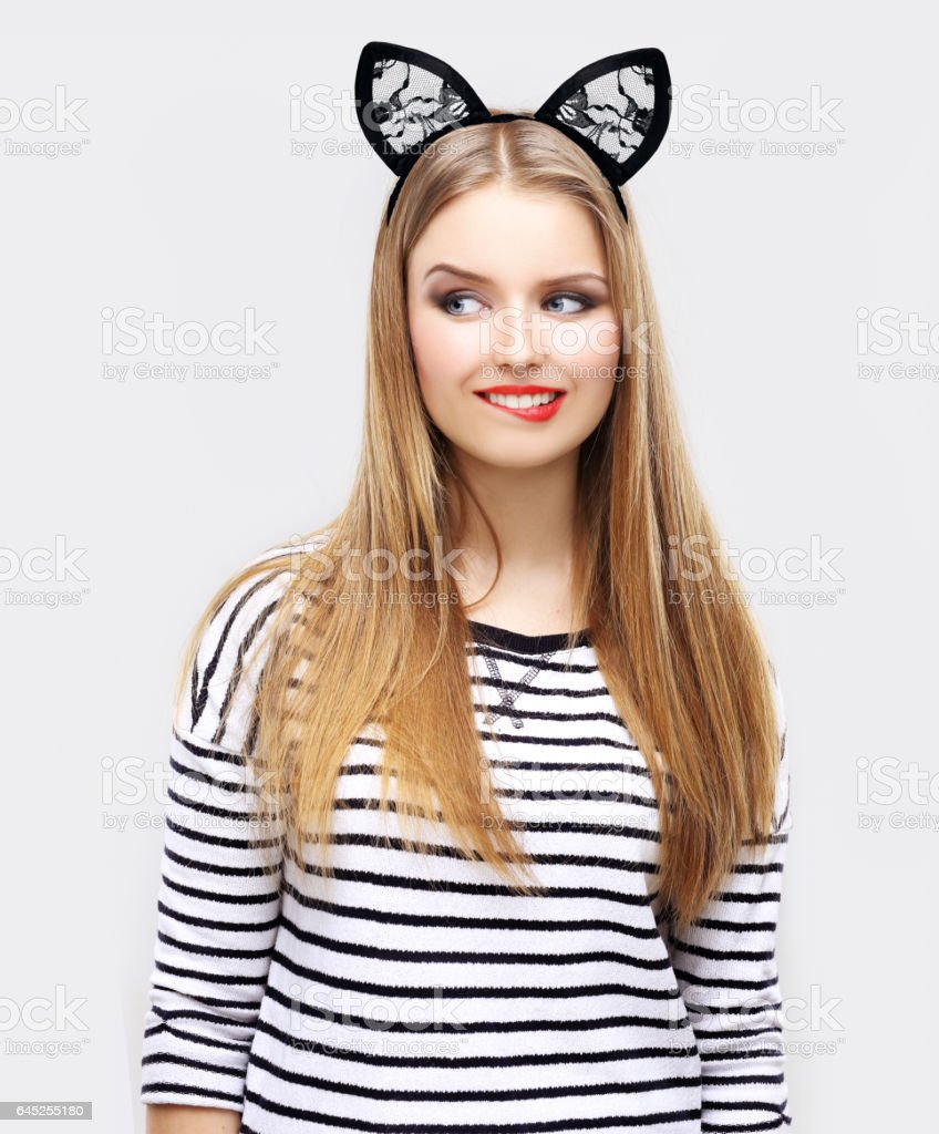 Young blond girl wearing bunny ears  , laughing at camera stock photo
