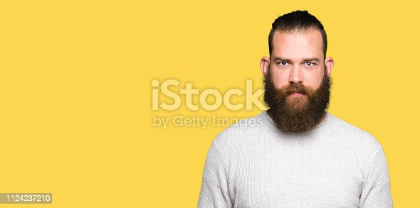 istock Young blond man wearing casual sweater skeptic and nervous, frowning upset because of problem. Negative person. 1124237210