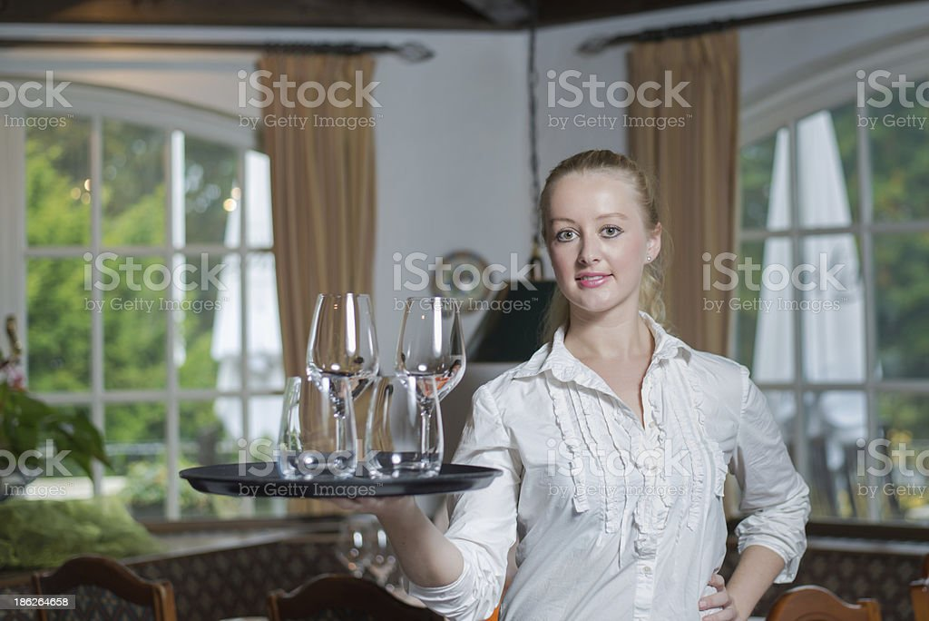 Young blond waitress in a restaurant royalty-free stock photo