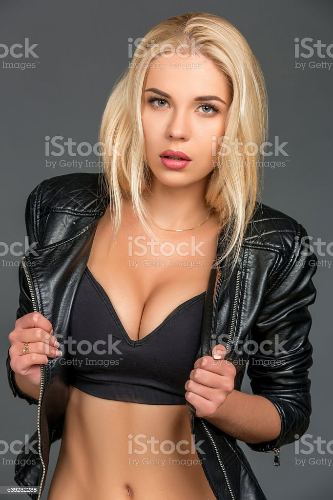 young blond woman in a black leather jacket royalty-free stock photo