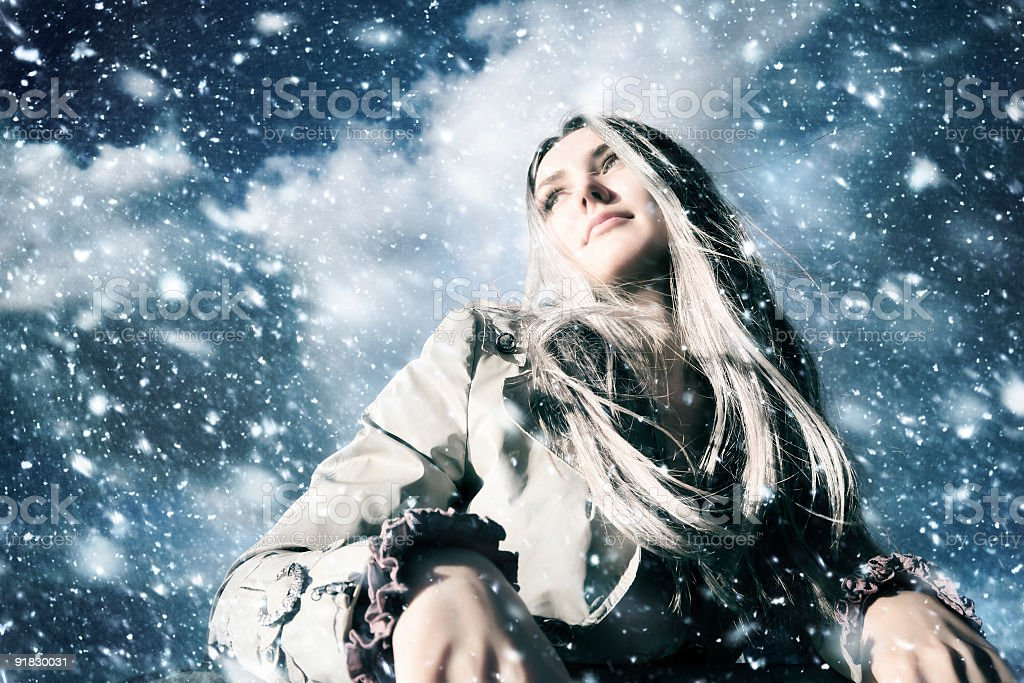 Young blond woman in a blizzard royalty-free stock photo