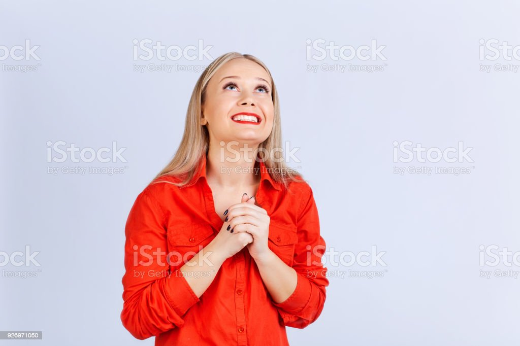 Young blond woman in casual clothes dreams looking stock photo