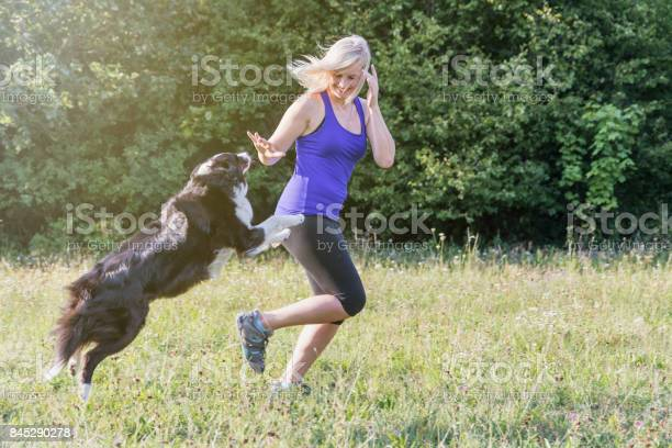 Young blond woman is running with her dog picture id845290278?b=1&k=6&m=845290278&s=612x612&h=gyb0l91yiwehddfguaoxmpz byir3zbv3tfsjjdfqxw=