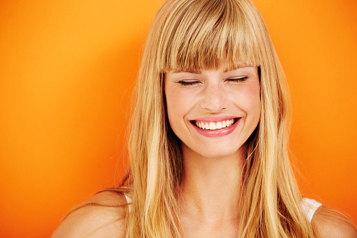 istock Young blond woman laughing 488312318