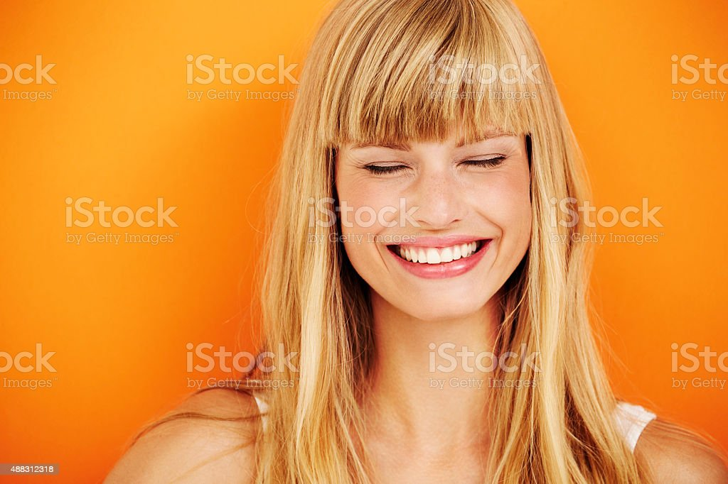 Young blond woman laughing stock photo