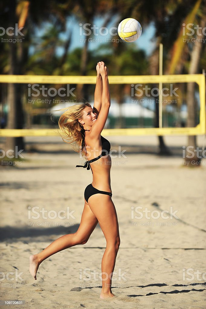 Young Blond Woman playing beach volleyball royalty-free stock photo