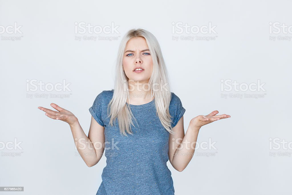 young blond woman with arms out shrugs shoulders stock photo