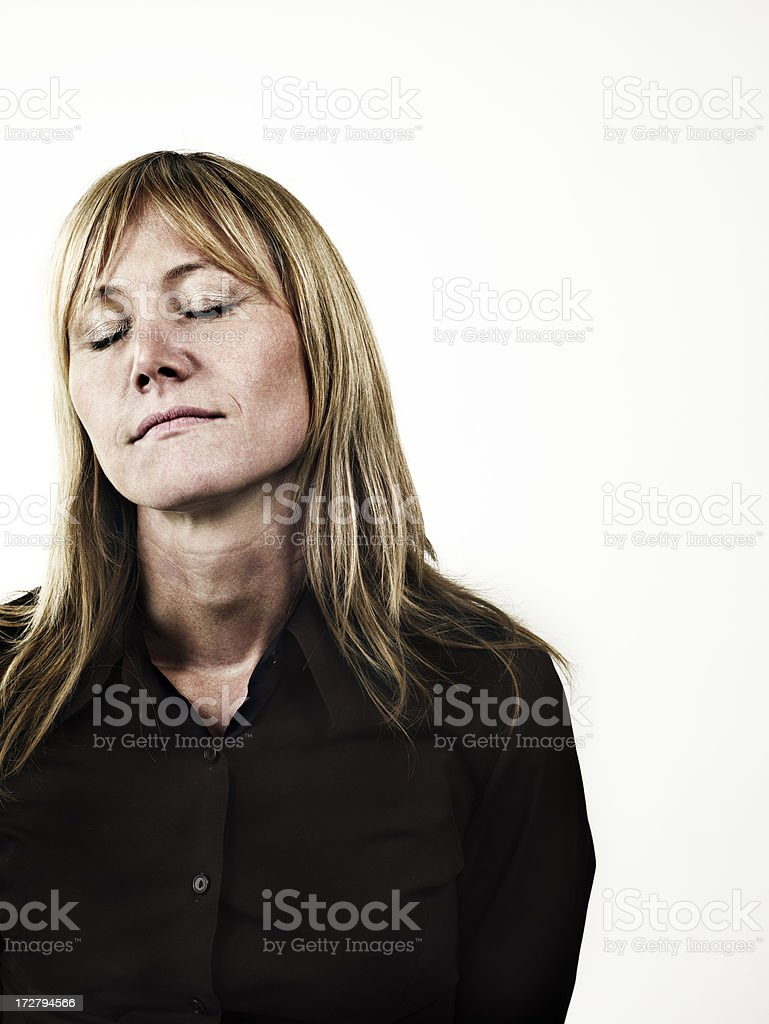young blond woman with closed eyes stock photo