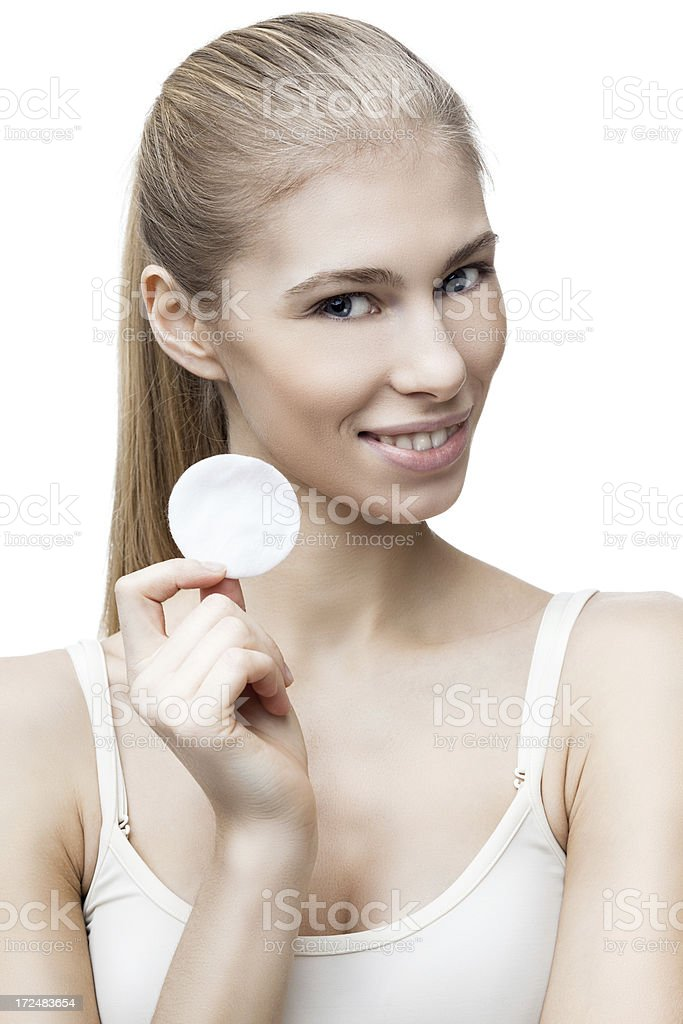 young blond woman with cotton pad isolated on white royalty-free stock photo