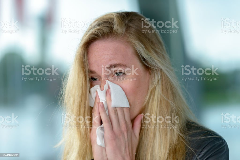 Young blond woman with hay fever stock photo