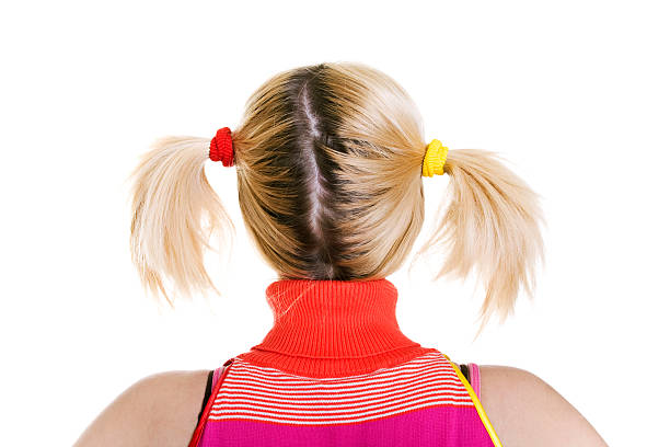 young blond woman with pigtails - pigtails stock photos and pictures
