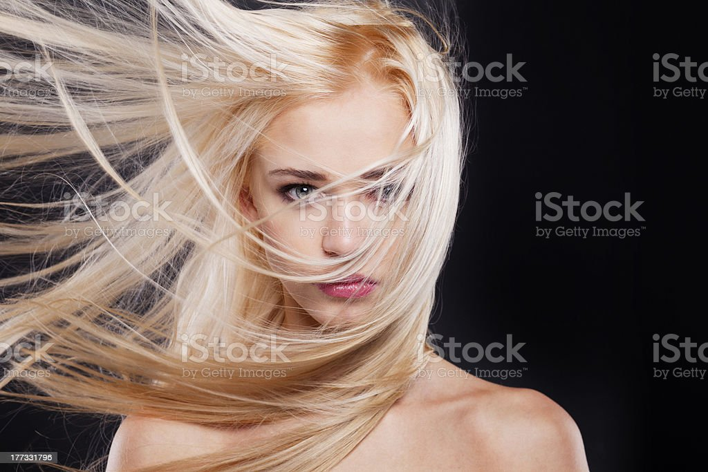 Young blonde beautiful woman in the wind royalty-free stock photo