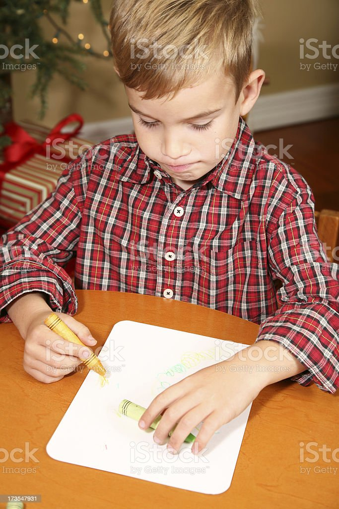 Young Blonde Boy Coloring With Crayons On Christmas Royalty Free Stock Photo