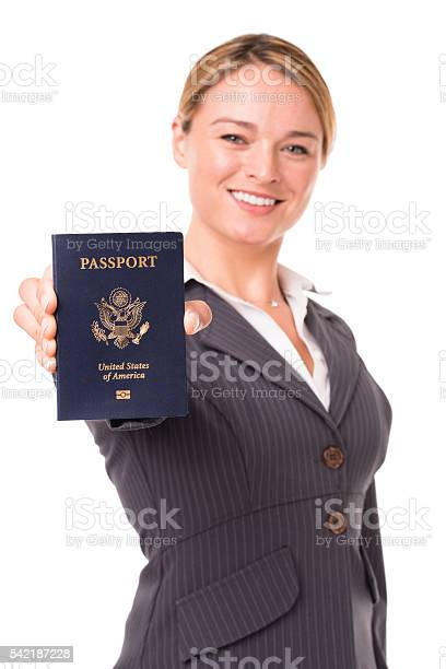 Young blonde businesswoman holding us passport on white picture id542187228?b=1&k=6&m=542187228&s=612x612&h=wfj3orqqqffcn7g27rivubhchvvrczpkxwq2t gz4gy=