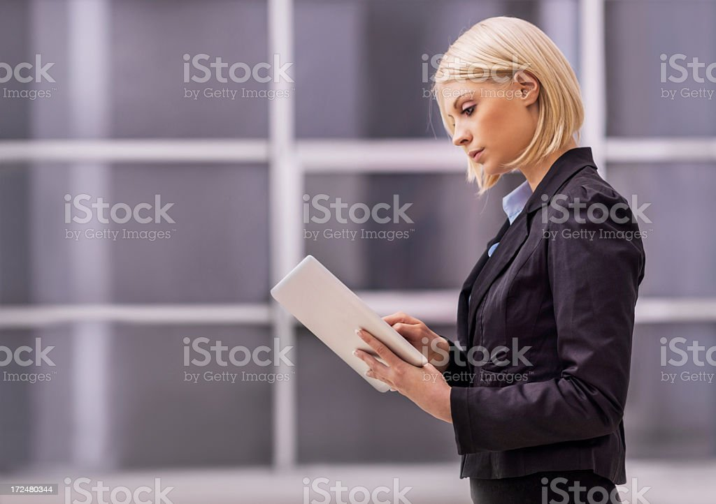 Young blonde businesswoman using a digital tablet. royalty-free stock photo