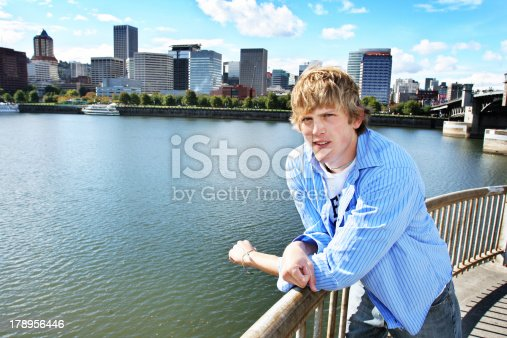 112301234 istock photo Young Blonde Caucasian Male at the Waterfront 178956446