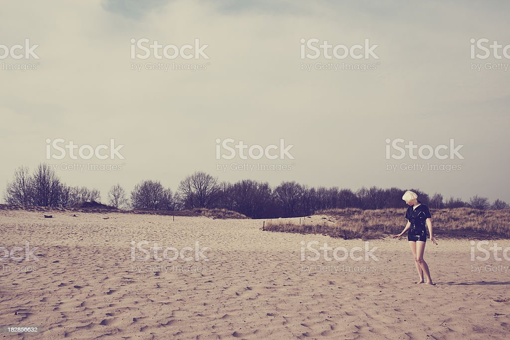 young blonde erotic woman in the desert royalty-free stock photo