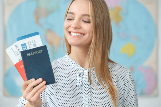 Young blonde female traveler in a tour agency holding passports picture id1165006324?b=1&k=6&m=1165006324&s=612x612&w=0&h=krrg4us1z9pp8n ru2iubvqbdqfkx12rq7lo6ow zzs=