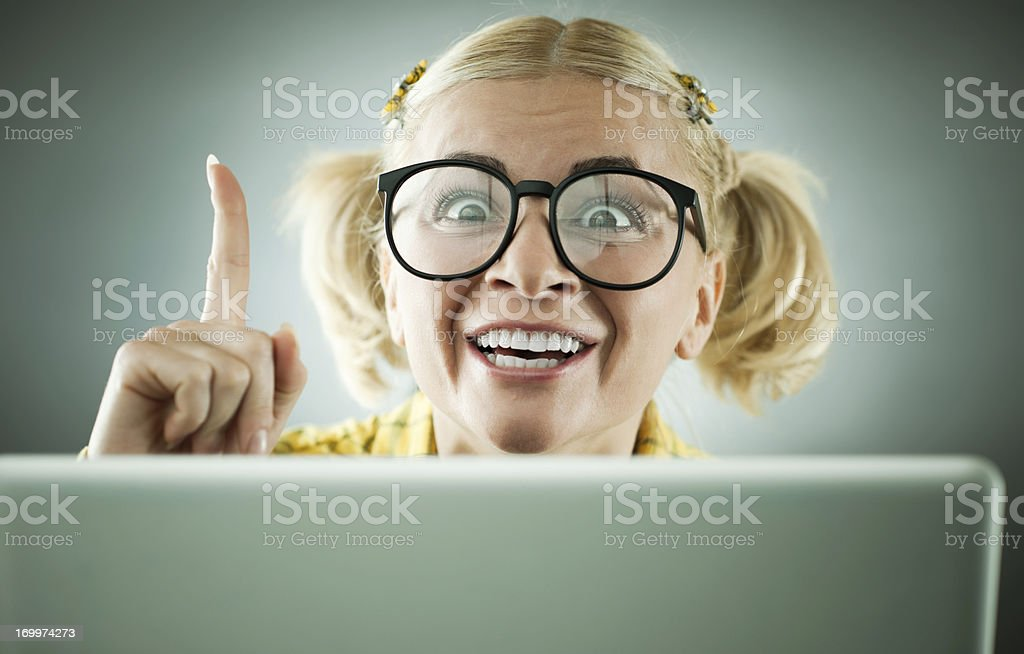 Young blonde geek nerd with her laptop. royalty-free stock photo