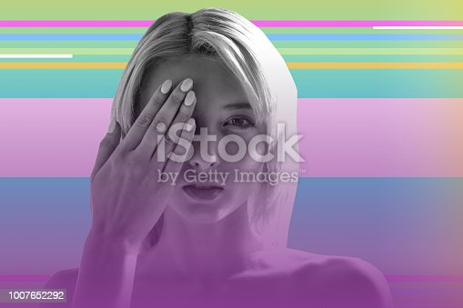 istock Young blonde girl closing one eye and checking her eyesight 1007652292