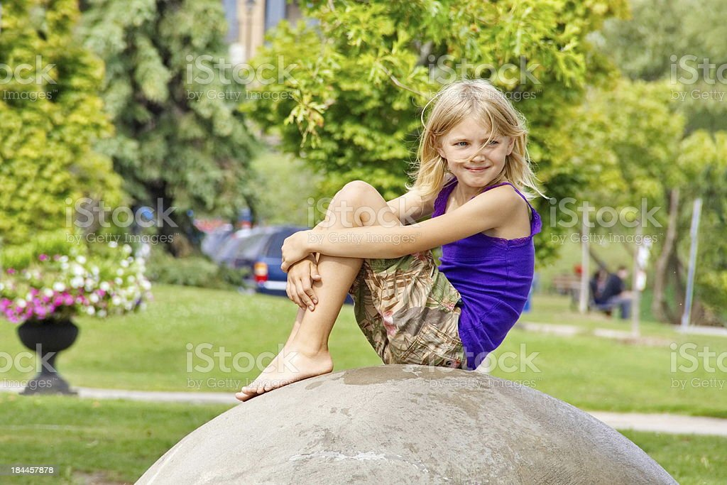 Young Blonde Girl Enjoys the Summer Breeze on a Break stock photo