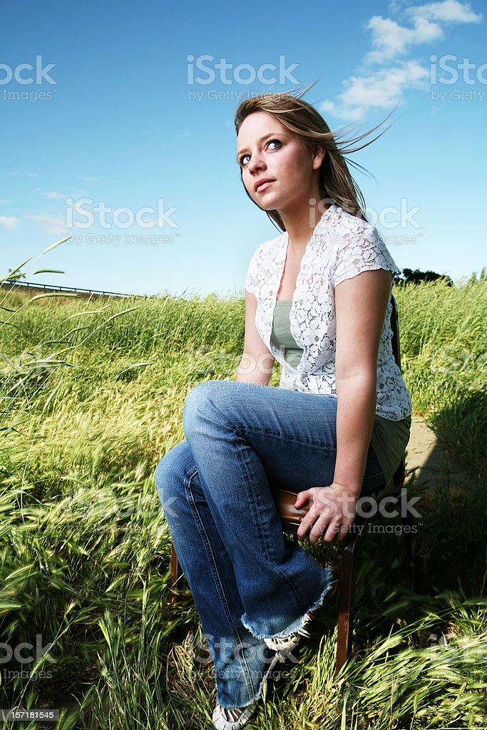Young Blonde Girl in a Large Field royalty-free stock photo