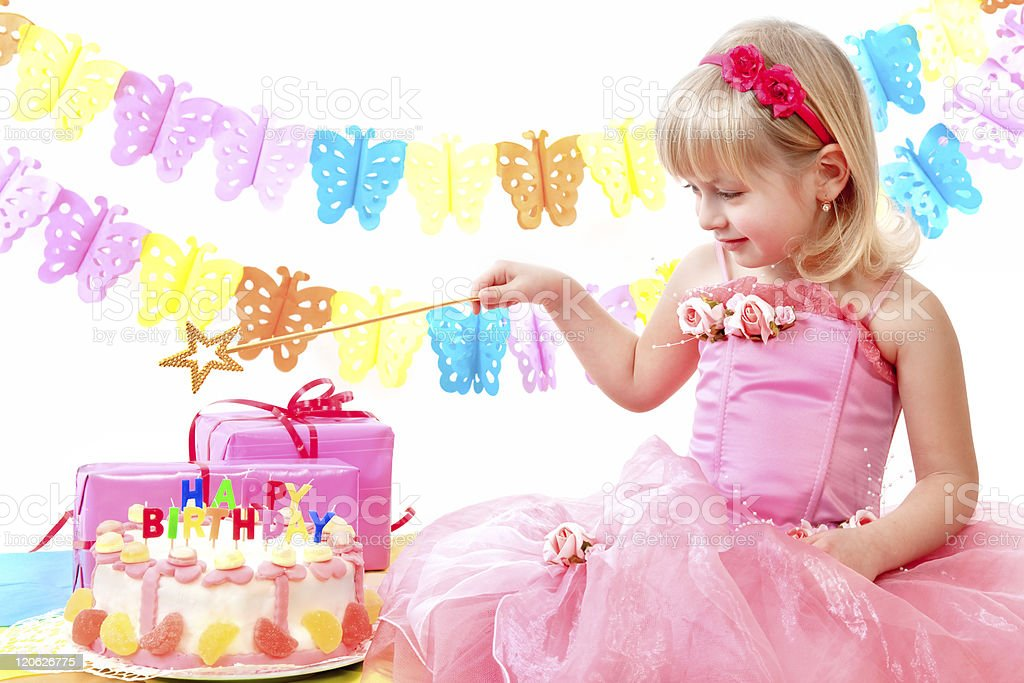 Young Blonde Girl In Pink Dress And Wand With Birthday Cake Stock