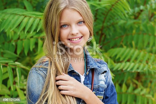 istock Young blonde girl is swearing jeans clothes 496101044