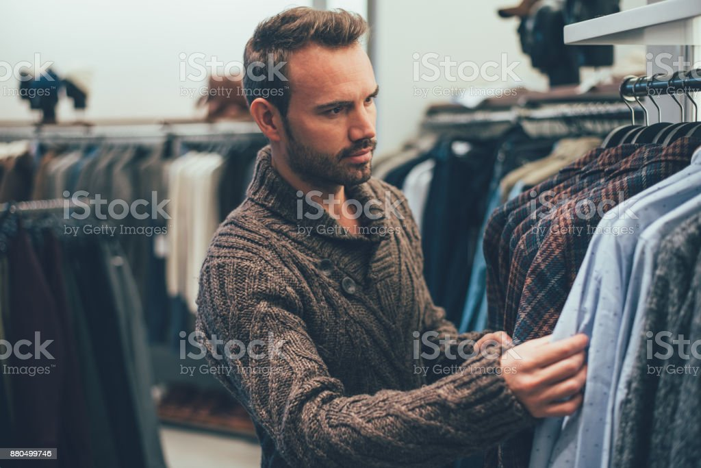 Young blonde man doing shopping in a store stock photo
